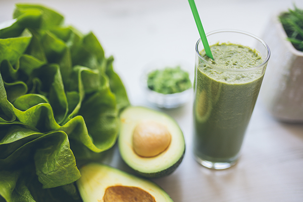 Avocado and spinach smoothie in a glass