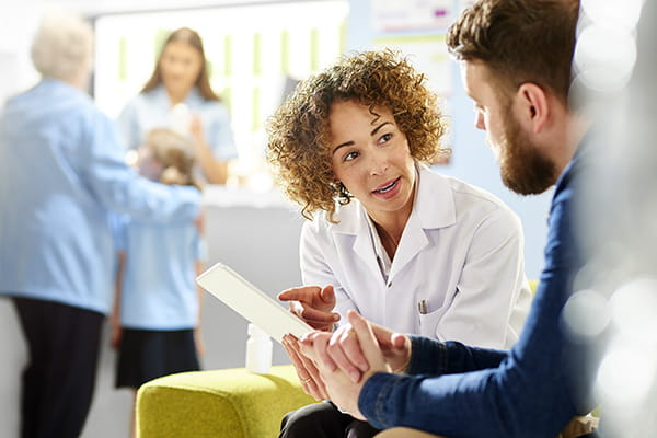 Pharmacist giving advice to a customer