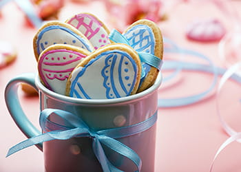 Mug containing Easter biscuits