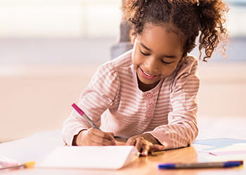 Child drawing in a notebook