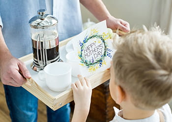Young child arranging a Mother's Day breakfast