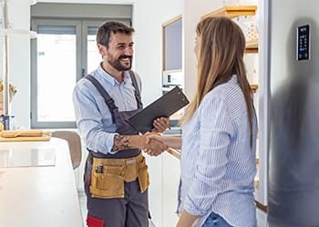 tradie shaking hands with a woman