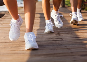 close up of feet of walking group