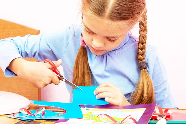 young girl making a home made card