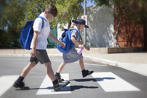 school children walking on the cross walk