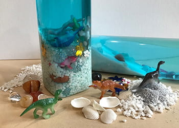 Sensory bottles with dinosaurs, shells and treasures