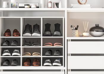 Shoes inside an organised wardrobe