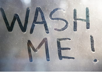 Dirty window with 'wash me' drawn onto it