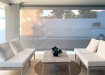 Patio with furniture and outdoor blind