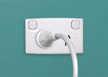 Plug plugged into a double power outlet