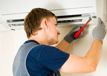 Man fixing air-conditioner