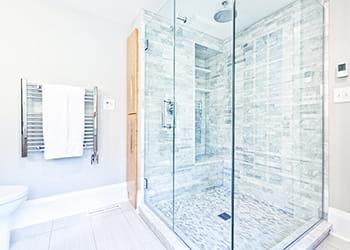 Bathroom with a frameless shower screen