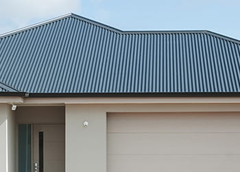 House with a grey metal roof