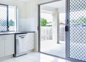 Kitchen with a security screen on the sliding door