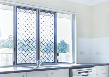 Kitchen with security screens on the windows