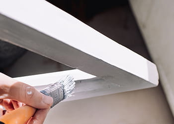 Painter painting a window frame