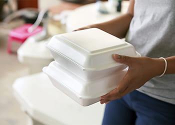 Hand holding polystyrene boxes