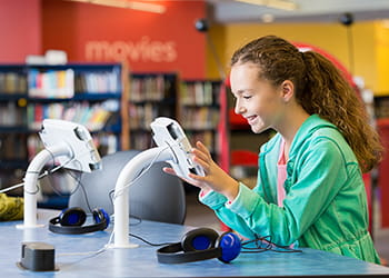 Child using touch tablet at the library