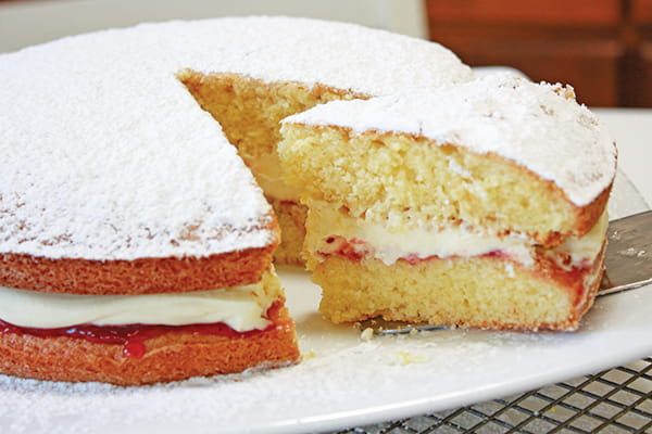 Victoria sponge cake on a white plate