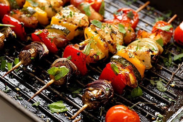 Skewers of vegetables and meat on the BBQ