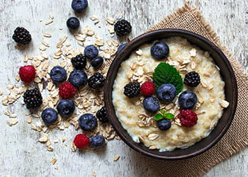 Bowl of oats topped with berries