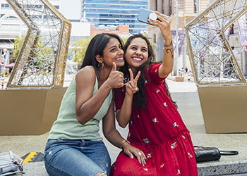 Two young ladies taking a selfie