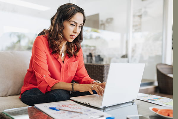 Lady working on a laptop at home