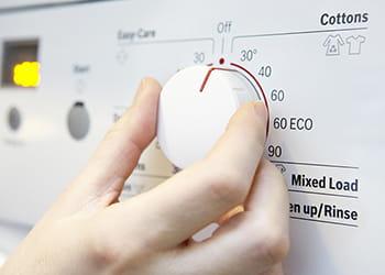 Washing machine dial being set
