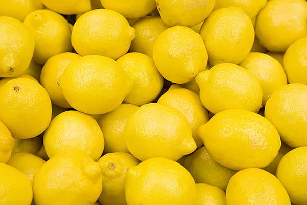 Pile of bright yellow lemons