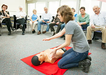 Group of adults at first aid class