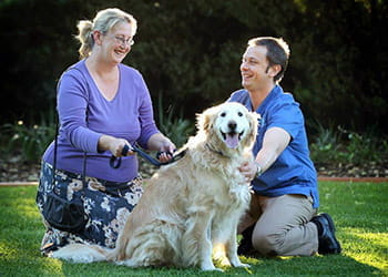 Dr Peter Kirkpatrick and dog owner with their dog - My Pet's Mobile Vet - Vet Services