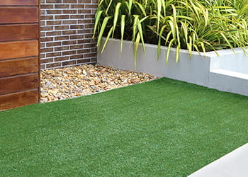 landscaped garden with artificial grass