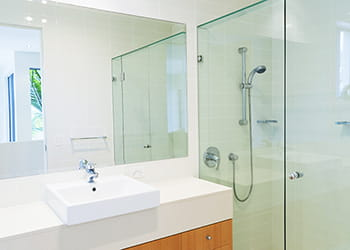 Bathroom featuring large glass mirror - Glass Services