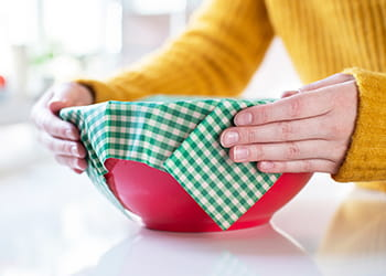Person covering bowl with beeswax wrap