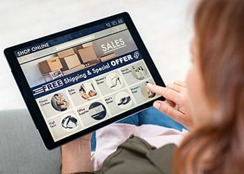 Lady online shopping on an iPad