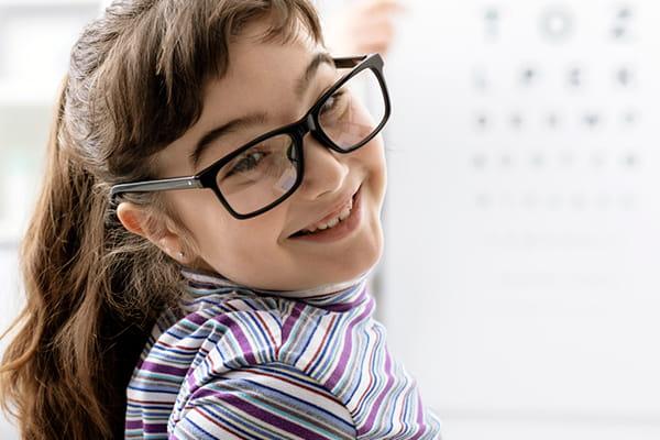Girl with black prescription glasses
