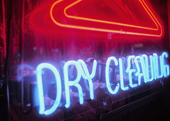 neon dry cleaners sign