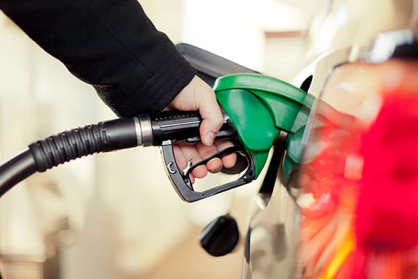 person filling their car with petrol