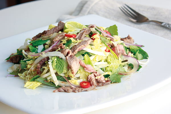 Tamarind beef salad on a white serving platter