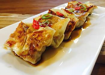 Chinese pan fried dumplings on a plate