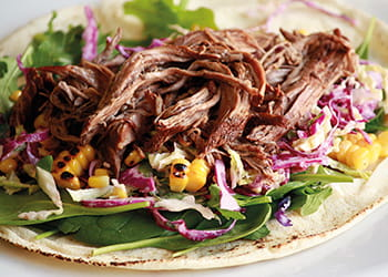 Slow cooked balsamic roast beef on a wrap with salad