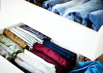 Neatly organised clothes in drawers