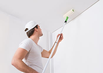painter painting a ceiling