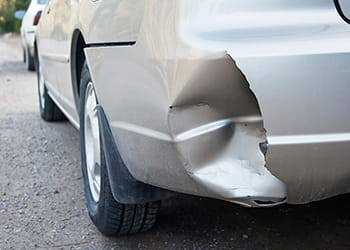 Car with bumper dent