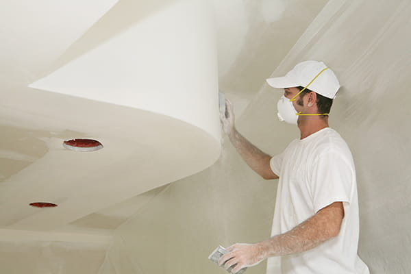 Workman working on a feature ceiling