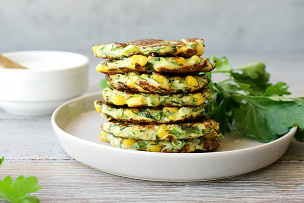 Stack of haloumi fritters on a plate