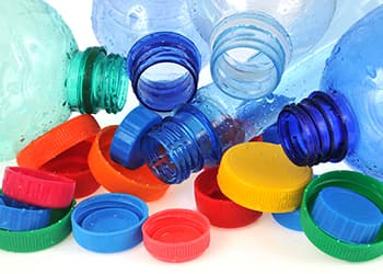 Plastic water bottle and coloured lids