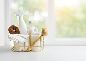 Basket of kitchen cleaning products