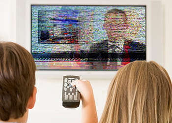 Couple watching TV with poor reception -