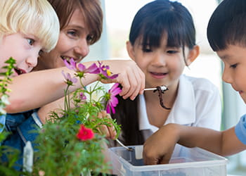 Kids with composting worms